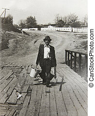 old vintage photo man with a fishing rod