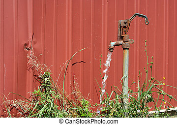 A Old water spigot with running water