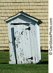 Old white outhouse with moon - A Old white outhouse with...