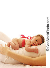 one cute little newborn baby lying on his mom - a one cute...