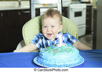 A One Year Old Boy Cake with big smile.