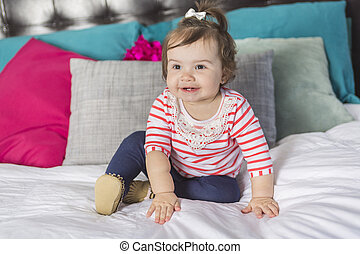 one year old girl in bed