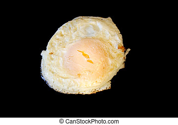 Over easy up egg frying isolated on black - A Over easy up ...