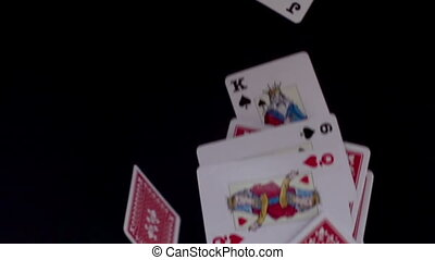 a pack of cards being thrown in the air shot in super slow motion with the sony FS700 high speed camera