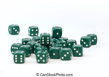 A pack of dices - group of green dices randomly scattered on...
