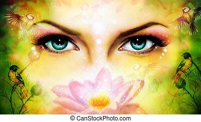 A pair of beautiful blue women eyes beaming up enchanting from b