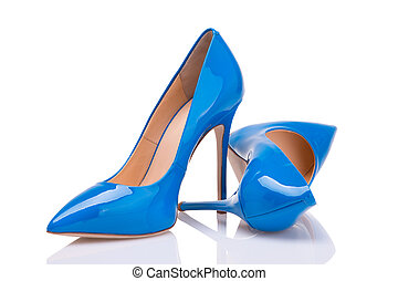 A pair of blue lacquer shoes on a white background