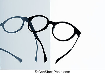 a pair of eyeglasses - closeup of a pair of black eyeglasses...