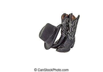 A pair of fancy black cowboy boots with a black felt homburg
