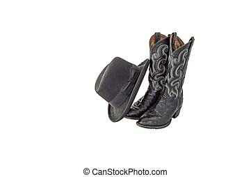 A pair of fancy black cowboy boots with a black felt homburg