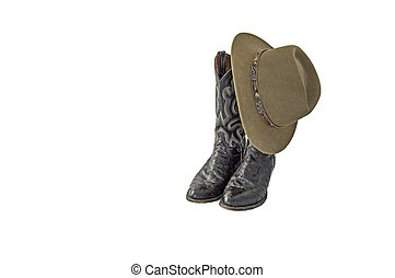 A pair of fancy black cowboy boots with a green felt outback hat