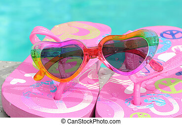 sunglasses  - A pair of flip-flops with a sunglasses