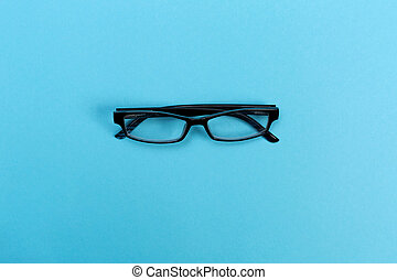 A pair of glasses on a blue background