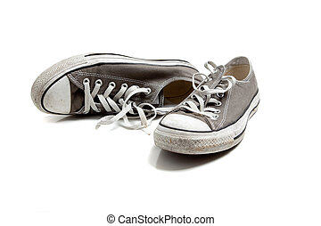 a pair of grey sneakers on white