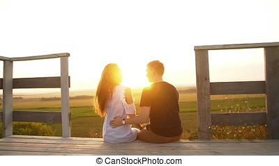 A pair of lovers watching the sunset. - A pair of lovers...