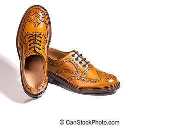 A pair of Luxury Male Full Brogued Tan Oxford Shoes....
