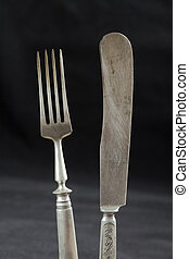 A pair of old cutlery
