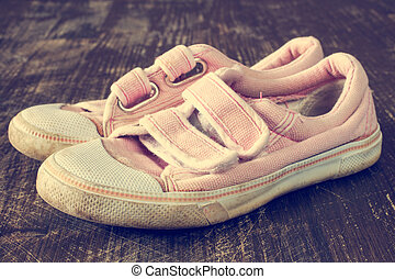 A pair of old pink sneakers