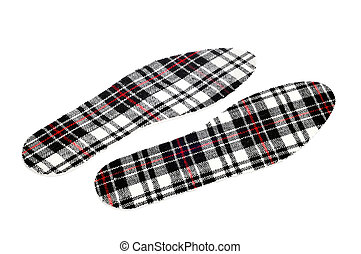 patterned insoles - a pair of plaid patterned insoles on a ...