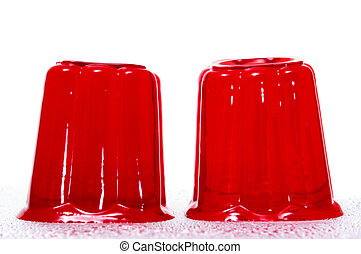 a pair of red gelatins on a white background