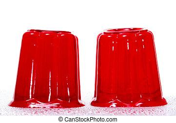 gelatin - a pair of red gelatins on a white background