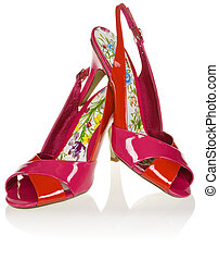 A pair of red women\'s high-heel shoes on white background