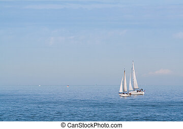 A pair of sailboats in the sea