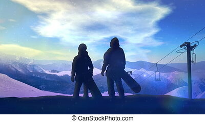 A pair of snowboarders standing on the slope.