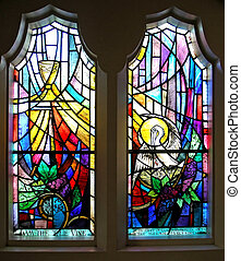 A pair of stained glass windows in a church
