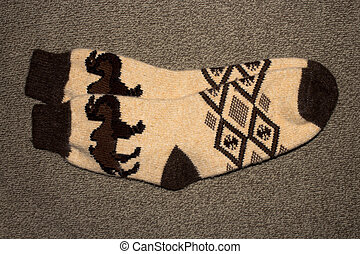 A pair of warm winter wool socks with patterns.