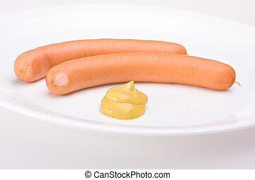 a pair of wieners on a white plate