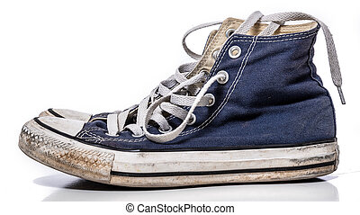 A pair of worn, vintage styled, classic sneakers on a white background