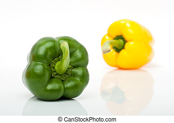 yellow and green pepper isolated on white background