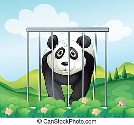 A panda inside the cage