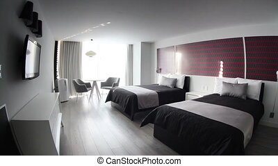 a panning shot in a cool boutique style hotel room