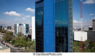 a panning time-lapse of the mexico city skyline