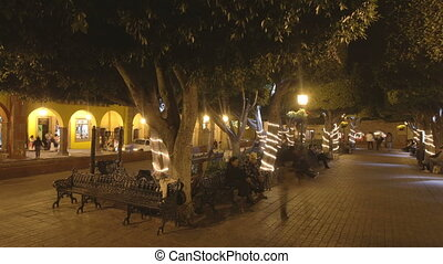 a panning timelapse of the zocalo at night in san miguel de allende, mexico