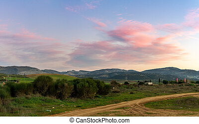 A panorama landscape view of the Sierra de las Nieves in Andalusia at sunset