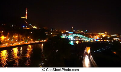 A panorama of the night colorful city from the funicular.
