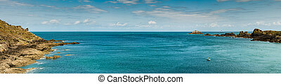 panorama view of rocky coast and ocean landscape with a lone fisherman in a small boat