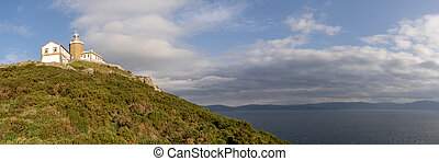 panorama view of the lighthouse at Fisterra in Galicia