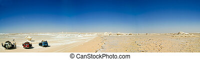 A panoramic stock photograph of a 4WD safari in the White Desert in Egypt.