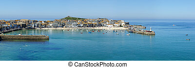 A panoramic view of St. Ives harbour in Cornwall, UK.