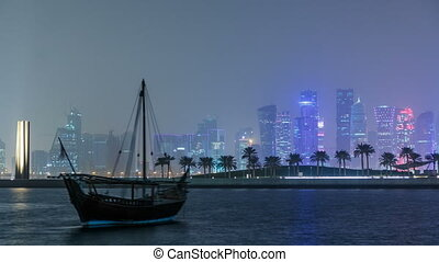 A panoramic view of the old dhow harbour night timelapse in Doha, Qatar, with