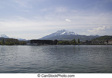 A panoramic view of the snow-capped Swiss Alps from the old part of Lucerne, which is located in the center of Switzerland. Blue Lake lucerne.