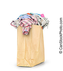 A paper bag full of clothes isolated on a white background