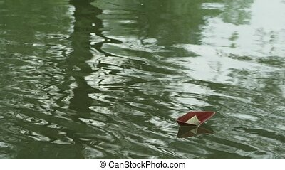 a paper boat floating on the river
