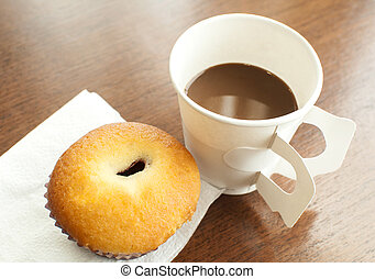 A paper cup of coffee and bakery