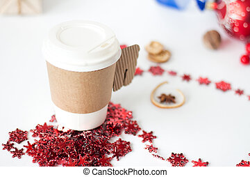 A paper cup of coffee, peppermint mocha, displayed with christmas decorations on white background