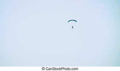 a parachute and a man in the sky. Extreme sport